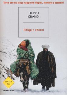 Rifugi e ritorni. Storie del mio lungo viaggio tra rifugiati, filantropi e assassini - Filippo Grandi - copertina