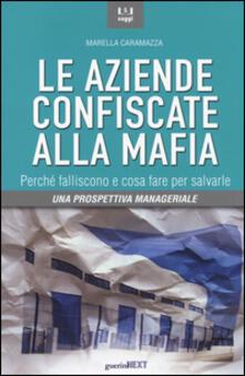 Le aziende confiscate alla mafia. Perché falliscono e cosa fare per salvarle. Una prospettiva manageriale.pdf