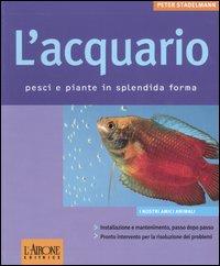 L' acquario. Pesci e piante...